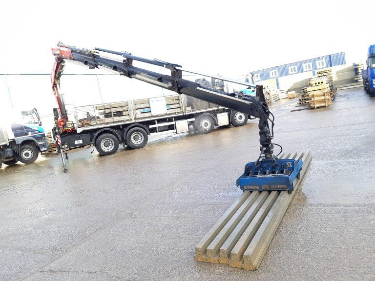 Bespoke grabber unloading concrete beams from rigid