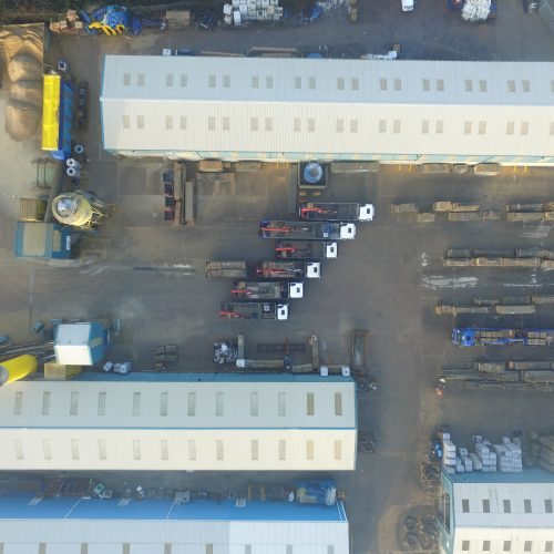 overhead image of Floorspan yard with lorries lined up full size