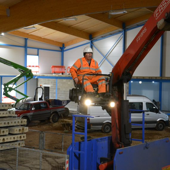operator operating commercial crane to move hollowcore planks