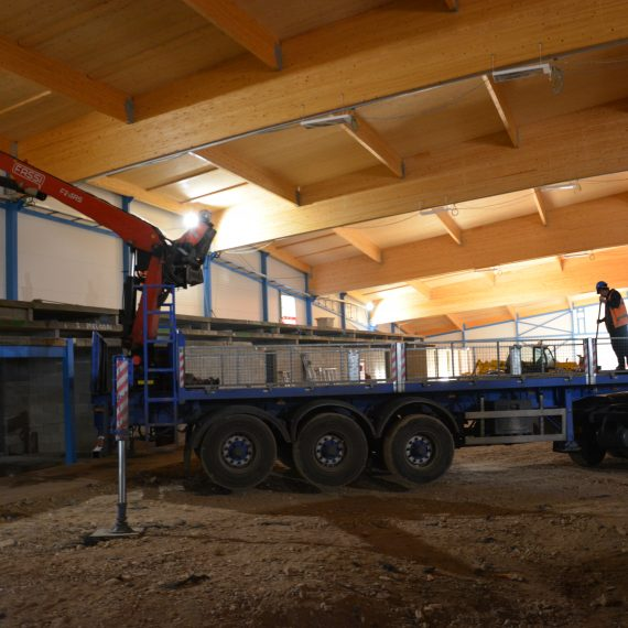inside commercial ice rink with crane building second floor