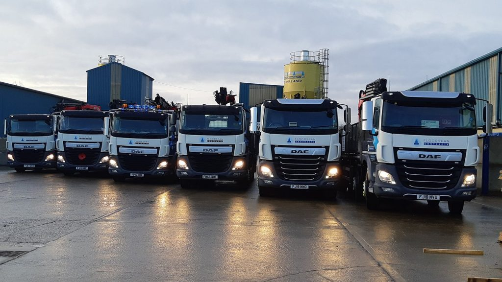 six lorries lined up ready for concrete delivery