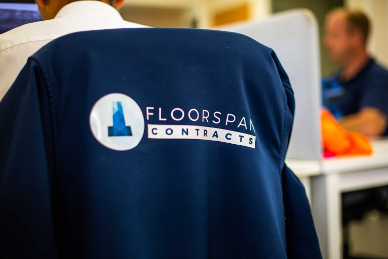 Floorspan contracts jacket on the back of a chair