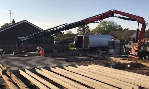 Crane at full reach moving beams